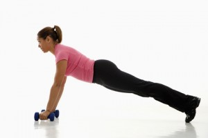 woman plank pushup weights